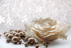 Pearl necklace and rose Stock Photos