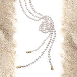 Pearl necklace on sand Royalty Free Stock Photo