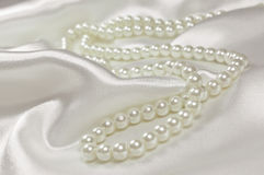 Pearl necklace on a satin or silk background Stock Photo