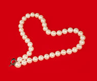 Pearl necklace in the shape of heart Stock Image