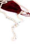 Pearl necklace and velvet bag Royalty Free Stock Photos