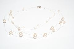 Pearl necklace on white isolated background Stock Image