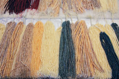 Pearl necklaces. The background of colored pearl necklaces stock photo