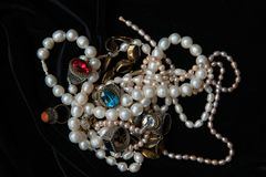 Pearl necklaces and rings with glasses from India. Pearl chains and rings with coloures glass such as Swarovsky look liked as rubin and sapphire. From India royalty free stock photos