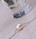 Pearl  and perfume Stock Image