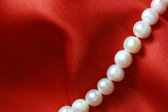Pearl On Red Stock Images