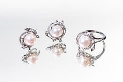 Pearl ring and earring Stock Photos