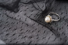 a pearl ring on the lace fabric Stock Image