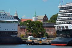 Pearl Seaways and Koningsdam cruise ships in Oslo, Norway. Oslo, Norway - June 26, 2018: Pearl Seaways and Koningsdam cruise ships in Oslo harbour, with royalty free stock images