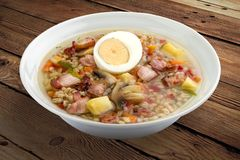 Pearl soup with bacon and egg. royalty free stock images