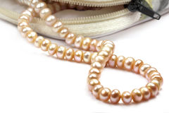 Pearl string from small ornament pouch Royalty Free Stock Images