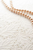 Pearl on white lace Royalty Free Stock Photography