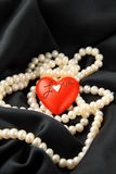 Pearl white with red hearts Royalty Free Stock Photos