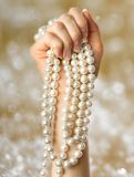 Pearl in the woman hand Royalty Free Stock Photography