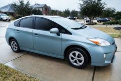 Pearland, TX/USA - 01 24 2014: Toyota Prius-auto in ijs tijdens zeldzaam Ijsonweer wordt behandeld in Houston, TX-gebied dat Stock Foto
