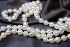 Pearls 02. White pearls on satin