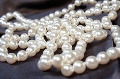 Pearls 03. White pearls on satin Stock Images
