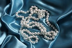 Pearls. A necklace on a silk fabric Royalty Free Stock Photo