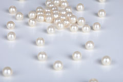 Pearls. The pearls scattered on a light surface Stock Images