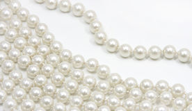 Pearls. On a white background Royalty Free Stock Photography