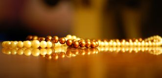 Pearls. Pearl necklace resting on a dresser Royalty Free Stock Image