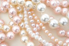 Pearls. Pearl jewelry necklaces in white and pink. Shot from above Stock Images