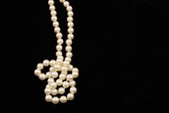 Pearls. Strand of pearls on black background Stock Image