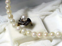 Pearls. Pearl necklace and ring Royalty Free Stock Photo