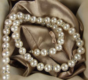 Pearls. On a silk fabric Royalty Free Stock Photography