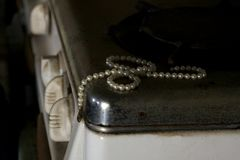 Pearls on antique stove stock photos
