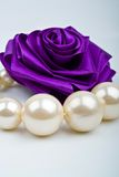 Pearls and artificial roses Stock Photography