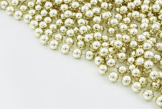 Pearls background. Golden pearls background for holidays Stock Photography