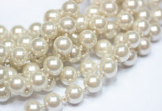 Pearls background. Pearls on a white background Stock Photos