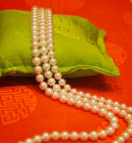 Pearls beads. Series pearls object on orange and greenbackground Stock Image