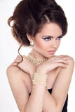 Pearls. Beautiful woman with evening make-up. Jewelry and Beauty Royalty Free Stock Image