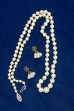 Pearls on Blue Velvet Stock Photos
