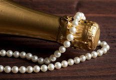 Pearls and champagne Royalty Free Stock Image