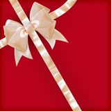 Pearls color gift bow with ribbon on red. EPS 10 Royalty Free Stock Photos