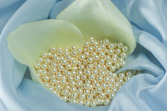 Pearls  on a colored background fabric Stock Photography