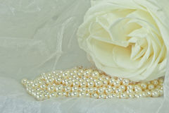 Pearls  on a colored background fabric Royalty Free Stock Photography