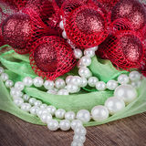 Pearls with creative Christmas decoration on a wooden background Royalty Free Stock Images
