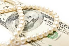 Pearls and dollars Royalty Free Stock Photography