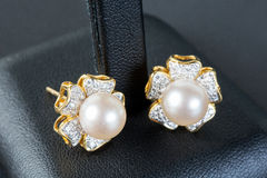Pearls earrings Royalty Free Stock Images