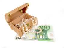 Pearls and euros Royalty Free Stock Image