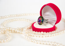 Pearls and expensive ring Stock Photography