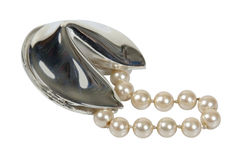 Pearls in Fortune Cookie. String of pearls in a silver fortune cookie for obtaining the fortune of the future - path included Stock Images