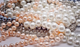 Pearls, glass and plastic jewelry. Sparsely piled jewelry - pearls, plastic and glass beads royalty free stock photos