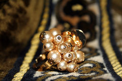 Pearls and gold ring Stock Photos