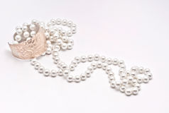 Pearls and golden bracelet. On white background royalty free stock photos