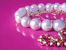 Pearls and golden jewelry Royalty Free Stock Images